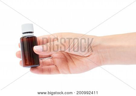 Hand holding homeopathic pills isolated on white background.