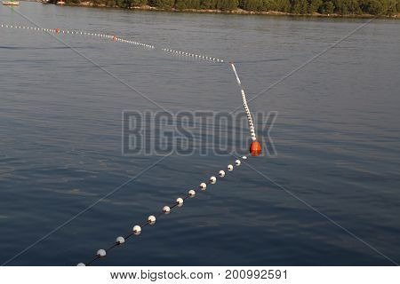 Set of buoys in the sea .