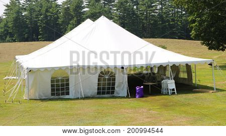 large white events or wedding tent in a rural setting