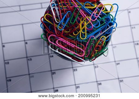 Close-up of colorful paper clips in bucket