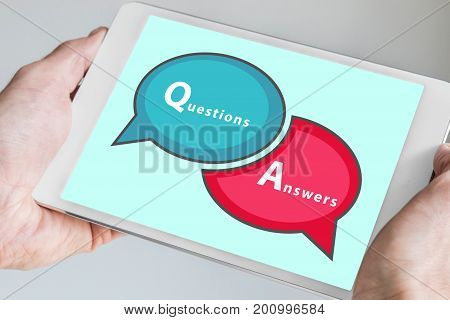 Questions and Answers Q&A session concept with hands holding modern tablet or smartphone to be used as slide background