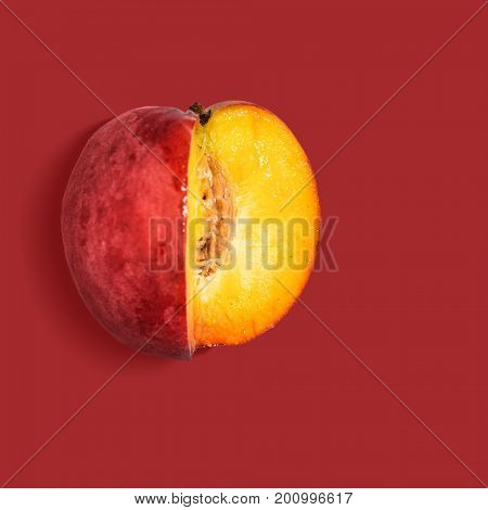 Fresh nectarine on red background, view from above