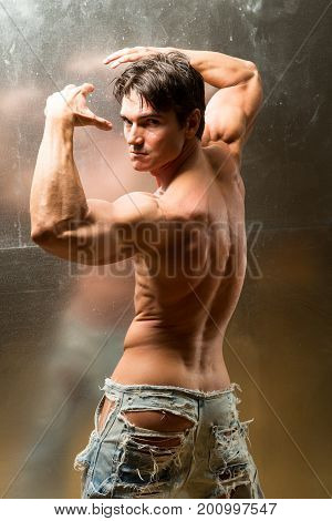 The sultry photo is of a man flexing.