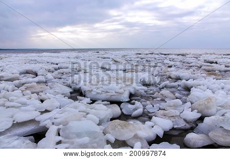 Cold winter landscape - ice covered ashore the Baltic sea in before sunset at Narva, Estonia