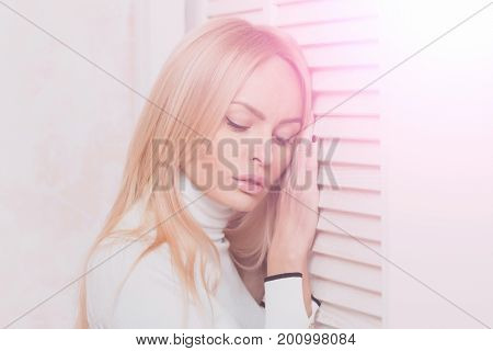 Girl With Closed Eyes Posing At Window Shutters