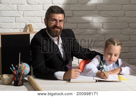 Girl And Father In Classroom On White Brick Background