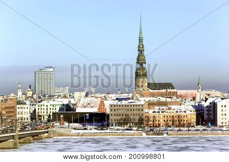 LATVIA, RIGA, JANUARY, 10, 2016 -  Panorama view of Riga city, capital of Latvia. The embankment of the Daugava River near Stone Bridge.