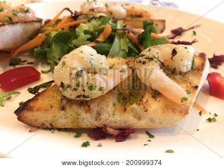 Italian Starter - Bruschetta Con Gamberetti - Marinated tiger prawns with garlic, basil and olive oil on toasted bread