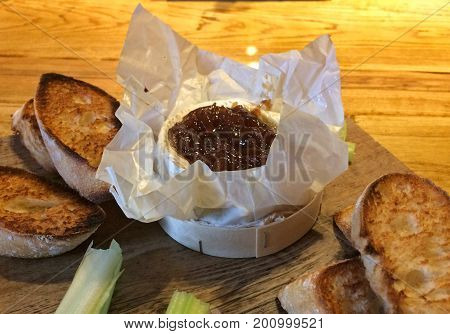 Typical UK's starter - Baked Camembert cheese with onion chutney