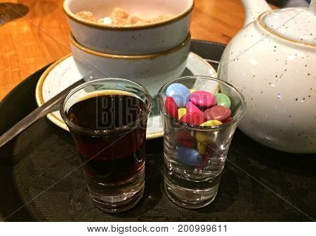 Shot of Jagermeister (German spirit) served with candy