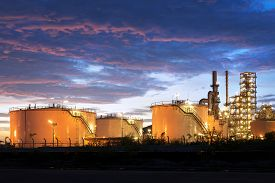Industrial oil tanks in a refinery at twilight