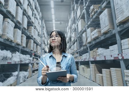 Young Attractive Asian Manager Woman Looking, Picking, Replemishment, Receiving Inventory At Store W