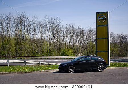 Teplice, Czech Republic - April 20, 2019: Black Car Opel Astra Stand Near Opel Service In Spring