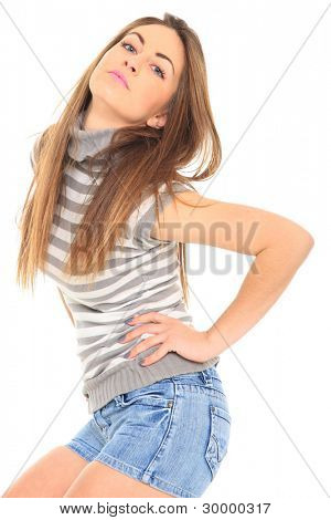 Beautiful girl in short blue jeans isolated on white