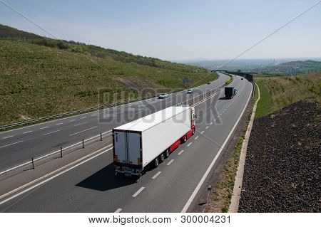 Oparno, Czech Republic - April 20, 2019: Camion And Car On D8 Highway In Czech Central Mountains