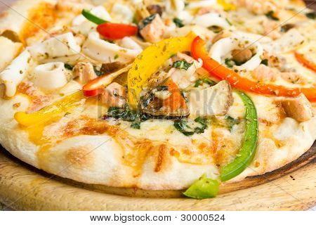 Closeup delicious pizza with seafood