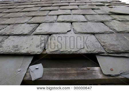 Damaged Roof With Missing Slates