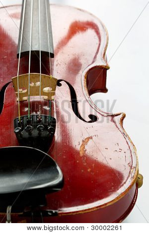 old scratched violin on white