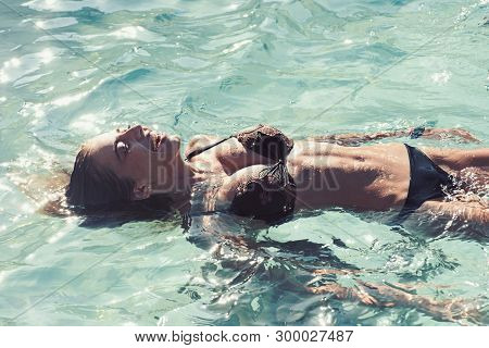 Summer Vacation And Travel To Ocean. Beauty Of Woman Is Moisturized In Bath. Relax In Spa Swimming P