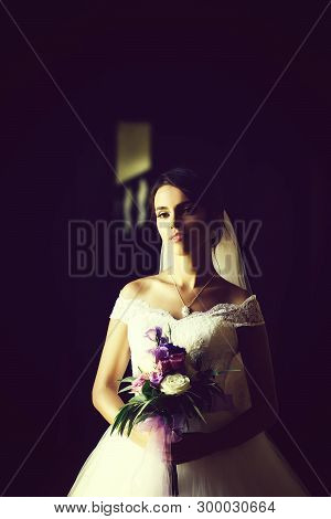 Young Sexy Woman Or Girl Bride With Makeup On Pretty Face And Veil In Hair Holding Wedding Bouquet O