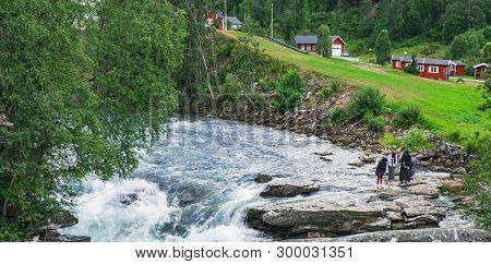 Gudbrandsjuvet , Norway - July 31, 2018: Muslim Women Tourists In Traditional Clothes Visit And Enjo