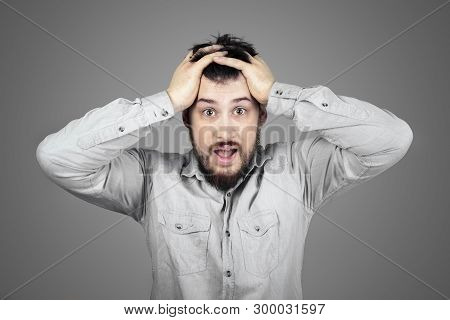 Shouting Frustrated Guy Tearing His Hair. Problems Concept.man With Problems At Work.