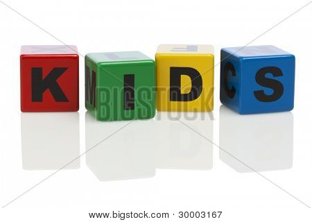 The word kids spelled with alphabet building blocks isolated on white