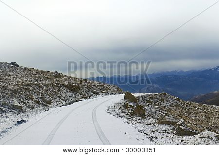 Snow-covered Road On A Mountain Pass