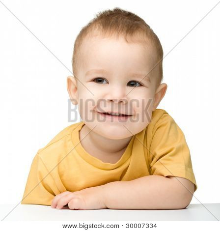 Portrait of a cute and happy little boy, isolated over white