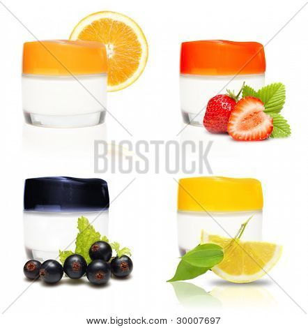 Containers of cream and fresh fruits and berries isolated.