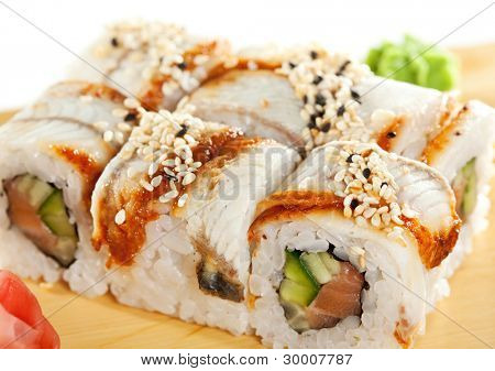 Roll made of Fresh Salmon, Smoked Eel, Cream Cheese and Cucumber inside. Topped with Smoked Eel (unagi)