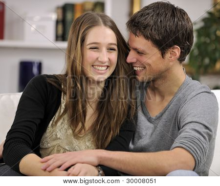 happy couple in living room hugging