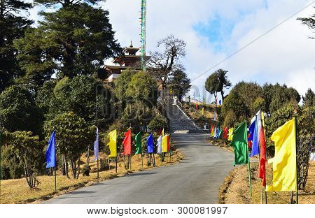 Road And Stairs Decorated With Colored Flags To Druk Wangyel Monastery From Dochula Pass In Bhutan