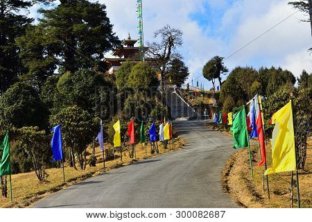 Road And Stairs Decorated With Colored Flags To Druk Wangyel Monastery From Dochala Pass , Bhutan