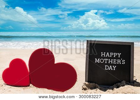 Happy Mothers Day Beach Background With Black Board And Heart