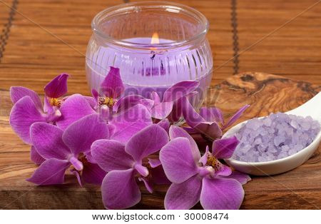 Spa scene with orchid, aromatic candle and bath salt