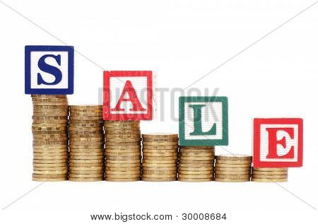 Coins in the form of the diagramme and word SALE