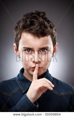 Boy Making Silence Sign