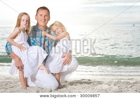 Happy family enjoy summer day at tropical beach.