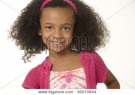Adorable cute smiling little girl with curly hair.  Image isolated against white background.