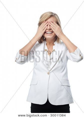 portrait of attractive  caucasian smiling woman isolated on white studio shot eyes closed by hands