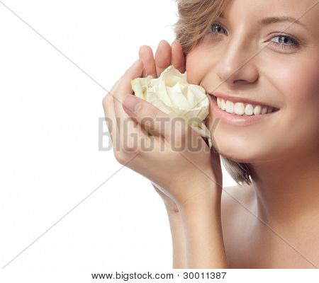 portrait of attractive  caucasian smiling woman blond isolated on white studio shot with flower