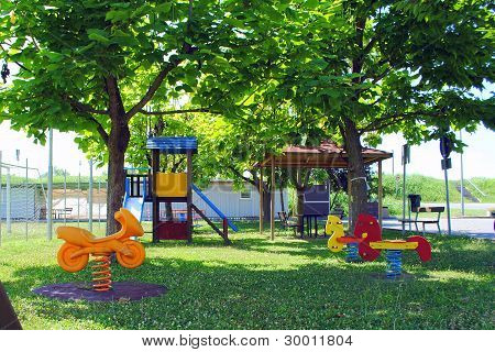 green kids playground with plastic games