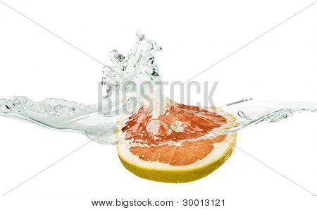 Fresh grapefruit with water splash isolated on white