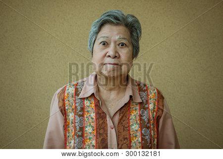 Portrait Of Furious Elder Woman. Enraged Elderly Female. Angry Asian Senior