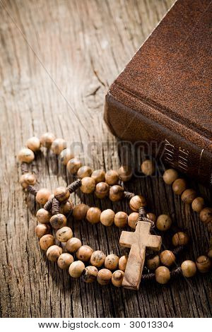 the wooden rosary and the Bible