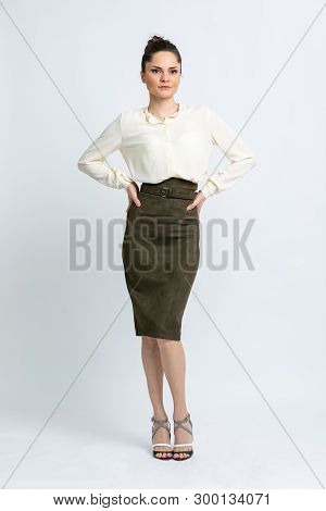 Model In White Blouse, Green Suede Skirt With Belt, Gray With White Sandals, With Silver Chain Aroun