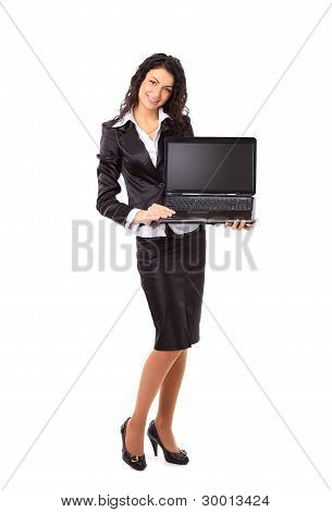 Brunette young businesswoman showing a laptop screen with copys pace
