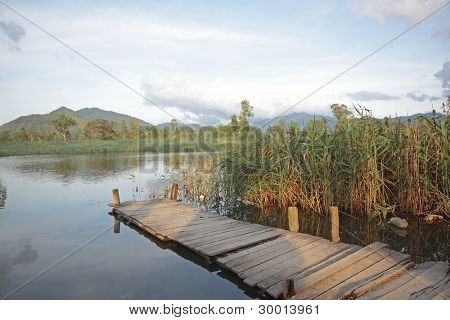 Jetty on lake at day