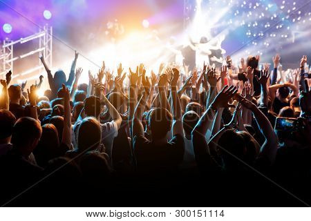 Crowd With Raised Hands On Music Concert
